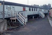 Two LNER teak bodied carriages at Perth's carriage sidings in departmental use. Does anyone know more about them and their fate?<br><br> Updates from replies:<br><br> They were used as accommodation for the carriage cleaners and were remarkably intact. Fixtures such as LNE mirrors etc. survived.<br><br> RB 24080 is now on the Great Central see <a target='external' href='http://www.rvp-ltd.org.uk/collection.php?vehicle=24080'>Railway Vehicle Preservations - RB 24080</a>.<br><br> TTO 23981 is also on the Great Central see <a target='external' href='http://www.rvp-ltd.org.uk/collection.php?vehicle=23981'>Railway Vehicle Preservations - TTO 23981</a>.<br><br> <br><br>[Ewan Crawford&nbsp;07/11/1988]