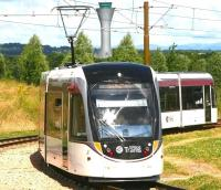 A city bound tram approaching Ingliston Park and Ride on 13 July 2014, shortly after commencing its journey from Edinburgh Airport.<br><br>[John Furnevel&nbsp;13/07/2014]