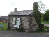 What would appear to be a former weighbridge building stands in the yard by Redmire station, as seen in May 2015  <br><br>[David Pesterfield&nbsp;25/05/2015]