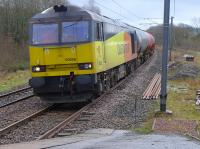 Colas 60056 enters Dalry with the diverted Dalston - Grangemouth empties.  The goods yard was located on the right.<br><br>[Bill Roberton