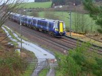 380 106 nears Dalry with a southbound service.  Evidence of much lost trackage.<br><br>[Bill Roberton