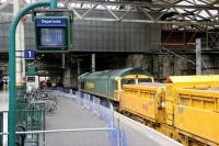 Sunday morning engineering work on the north side of Waverley in February 2006 in connection with the new 'Balmoral' through platform. Freightliner 66607 edges forward along platform 1 with a ballast train.<br><br>[John Furnevel&nbsp;26/02/2006]