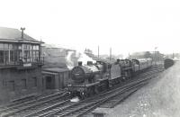 A Glasgow St Enoch - Fairlie Pier boat train runs through Parkhouse Junction on 6 July 1959 with 2P 40688 piloting Standard class 4 76091. Ardrossan shed stands in the background.  <br><br>[G H Robin collection by courtesy of the Mitchell Library, Glasgow&nbsp;06/07/1959]