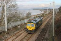 Possibly on a test run after repair, Freightliner 66598 ran light engine from Crewe to Carnforth and back on 12th February 2016. The loco is seen here on the northbound leg running past the incoming tide on a sunny afternoon at Hest Bank.<br><br>[Mark Bartlett&nbsp;12/02/2016]