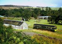 In August of 1964 a railbus leaves Blacksboat station westbound. The view gives a good general view of the station's situation. The goods shed is off to the right. [See image 54234]. The bridge in the background crosses the River Spey, today carrying the B9138.<br><br>[Andrew Saunders&nbsp;/08/1964]