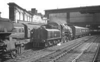 Upperby shed's Ivatt 2-6-0 43004 alongside platform 4 at Carlisle on 24 August 1963 with an unidentified working.<br><br>[K A Gray&nbsp;24/08/1963]
