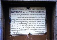 In 1964 the Great North of Scotland trespass sign remained on one of the station doors at Blacksboat, 41 years after the company was grouped into the London and North East Railway.<br><br>[Andrew Saunders&nbsp;/08/1964]