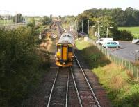 A Carlisle - Glasgow Central DMU comes off the double track section from Gretna Junction and approaches the platform at Gretna Green on 12 October 2006. Preparatory work in connection with the redoubling of the route between here and Annan is underway on the left. <br><br>[John Furnevel&nbsp;12/10/2006]