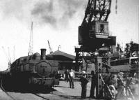 This photograph was taken on a Brownie 127 camera in, I think, 1955. It shows the Channel Islands steamer, the boat train and the Quay station. [See image 48062] for a more recent view of the station.<br><br>[Andrew Saunders&nbsp;//]