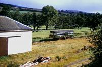 A railbus, leaving Blacksboat station westbound, passes the goods shed in 1964. [See image 54204].<br><br>[Andrew Saunders&nbsp;/08/1964]