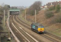 Going on standby at Preston as the duty <I>Thunderbird</I>, 57310 <I>Pride of Cumbria</I> ran light engine from Crewe Gresty Bridge on 16th February 2016 and is seen here passing Farington Curve Junction. <br><br>[Mark Bartlett&nbsp;16/02/2016]