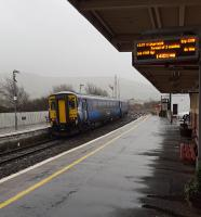 A Stranraer service heads south in the bucketing rain from Girvan.<br><br>[John Yellowlees&nbsp;16/02/2016]