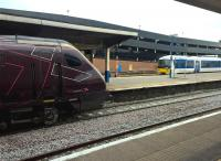 A fleeting meeting at Banbury on 28 December 2015. The Voyager will travel to Southampton via Oxford and Reading; while the Clubman will go to London Marylebone along the GW/GC route. The bright brake discs make the Voyager wheels look especially small.<br><br>[Ken Strachan 28/12/2015]