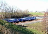 The 1128 ex-Tweedbank seen shortly after leaving Shawfair heading for Newcraighall on 15 February 2016. Photographed from the road bridge to the north of the station. <br><br>[John Furnevel&nbsp;15/02/2016]