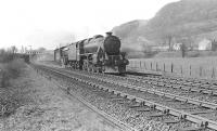 An up West Highland train passing through Dumbuck on Saturday 12 April 1958 with Black 5 44787 piloting K2 61786. The train has just passed below the lattice girder bridge carrying the L&D line between Bowling and Dumbarton. [See image 52480]   <br><br>[G H Robin collection by courtesy of the Mitchell Library, Glasgow&nbsp;12/04/1958]