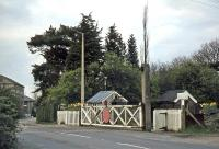 The crossing gates at Ardleigh as they appeared on April 11th 1977, looking northwards towards Ipswich. They were replaced by lifting barriers in 1983, the accompanying station having been closed in 1967.<br><br>[Mark Dufton&nbsp;11/04/1977]