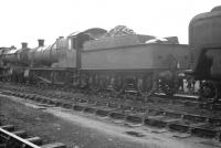 Ex-GWR Churchward 2-8-0 no 2384 in the sidings alongside Neath shed on 24 August 1962. [Ref query 3555]<br><br>[K A Gray&nbsp;24/98/1962]
