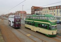 What a contrast. Two Blackpool <I>Balloons</I>, both on driver training duties, meet at Bispham on 29th February 2016. 717 <I>Walter Luff</I> on the right is in almost original condition with roof lights, sun visors, skirts and tip seats. 711 is heavily modified with no roof lights or skirts but rubber surround <I>bus windows</I> fitted. Most significantly 711 is also a <I>wide body</I> with the entrances extended so that it can operate from the new tram stops when required to supplement the <I>Flexity</I> fleet. <br><br>[Mark Bartlett&nbsp;29/02/2016]