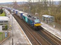 DRS 68001 <I>Evolution</I> takes the Grangemouth to Aberdeen intermodal service through Bridge of Allan on 27th February 2016.<br><br>[Bill Roberton&nbsp;27/02/2016]
