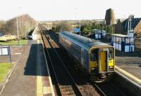Sprinter <I>bubble car</I> 153331, on a Northern service from Carlisle to Workington and the Cumbrian Coast, calls at Wigton on 15th February 2016. The distinctive building just beyond the platforms is an old windmill on the edge of the town. <br><br>[Brian Smith&nbsp;15/02/2016]