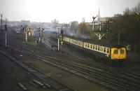 Daylight is waning and a damp chill is in the air around Norwich station on 13th November 1976. A 'Swindon' DMU set, coupled to a 'MetCam' set, makes a noisy and smoky departure from the terminus heading for Ely and Cambridge.<br><br>[Mark Dufton&nbsp;13/11/1976]