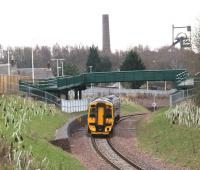 158728 runs south between the two new footbridges at Newtongrange on 29 February 2016 and is about to pass through the site of the 1908 station. The train is the ScotRail 1054 Edinburgh - Tweedbank.<br><br>[John Furnevel&nbsp;29/02/2016]