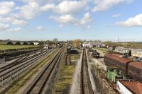 A general view of the preservation site at the Buckinghamshire Railway Centre at Quainton Rd. The preservation group occupies land on both sides of the surviving BR freight line from Aylesbury, seen here running through the middle. The two parts are linked by footbridges and some of the preserved stock and the old Rewley Road station building can be seen in this view. <br><br>[Peter Todd&nbsp;24/02/2016]