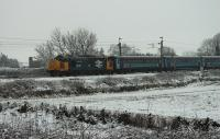 The light overnight covering of snow was already beginning to thaw (and it was raining) as 37401 <I>Mary Queen of Scots</I> headed north at Brock with the Northern Rail 1005hrs (M-F) Preston to Barrow-in-Furness service on 4th March 2016. <br><br>[Mark Bartlett&nbsp;04/03/2016]