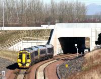 A northbound service on the Borders Railway about to pass below the Edinburgh City Bypass on 28 February 2016. The train is the 1031 ex Tweedbank, which has a mile to run to its next stop at Shawfair.<br><br>[John Furnevel&nbsp;28/02/2016]