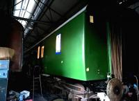 Down in the carriage shed, something stirred - the mystery being, why would the GC have a Southern Region coach? [See image 12077] - the answer, apparently, being that this is a DMU coach, and the Southern green is an undercoat for a dark green final coat.<br><br>[Ken Strachan&nbsp;27/02/2016]