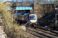 170403 on a service from Dunblane to Glasgow Queen Street passes overbridge 123, a structure which is shortly (March 2016) to be removed as part of the EGIP works.<br><br>[Colin McDonald&nbsp;07/03/2016]