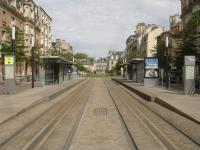 Looking north north west through Langlet tram stop, close to the magnificent Gothic Notre-Dame de Reims Cathedral, on the Reims light rail network. Of note is the lack of overhead catenary, with centre track induction power appearing to be utilised in order to give clear views of the Cathedral. The section of line to rear of view was out of use due to extensive works being carried out at the next, Opera, tram stop.  <br><br>[David Pesterfield&nbsp;24/07/2015]