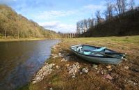 A rowing boat, at the Drygrange beat of the Tweed, with the Leaderfoot viaduct and fishermen's hut in the background.<br><br>[Ewan Crawford&nbsp;06/03/2016]