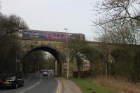 A Northern 153/150 combination crosses the Raikes Viaduct, immediately south of the site of Lower Darwen station, with a Clitheroe to Manchester Victoria service on 11th March 2016. <br><br>[Mark Bartlett&nbsp;11/03/2016]