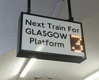 Pared-down departure information in the platform subway at Paisley Gilmour Street for passengers in a hurry. Interestingly the font appears to be a type of Johnson associated solely with former London Transport applications: sign maybe sourced from LUL?<br><br>[David Panton&nbsp;05/03/2016]