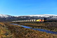 On a bright, early Spring, morning, Colas Class 60 No.60021 has just left the passing loop at Moy, heading for Inverness, with the Oxwellmains Lafarge - Inverness Lafarge cement tanks.<br><br>[John Gray&nbsp;14/03/2016]