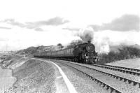 Fairburn tank 42059 has just run past the up distant for Neilston on 27 March 1962 with the 5.42pm Glasgow Central - Uplawmoor train. [Ref query 7522]  <br><br>[G H Robin collection by courtesy of the Mitchell Library, Glasgow&nbsp;27/03/1962]