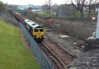 Works have commenced on the Cowlairs Incline out of Glasgow Queen Street.<br><br> <br><br> 66.520 (and another unidentified 66) with a PW train on the Cowlairs Incline viewed looking south from Keppochhill Road. Some track lifting has already occurred near to the camera.<br><br>[Rod Crawford&nbsp;20/03/2016]