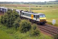 The Glasgow portion of the Lowland Sleeper passing Ravenstruther early on 11 July 2006. EWS 90022 brought the train north from Euston and has recently dropped the rear 7 coaches at Carstairs. [See image 49805].<br><br>[John Furnevel&nbsp;/07/2006]