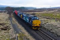 37218 and 37607 work the Mossend Down Yard to Forsinard engineers train. Pictured leaving Tomatin which was the only place in the Inverness area that wasn't foggy today.<br><br>[John Gray&nbsp;16/03/2016]