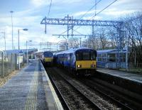 One in, one out. With frequent electric services as well as the hourly through trains to Falkirk Grahamston Cumbernauld station is not the relative backwater it once was. Through services to Edinburgh are planned for 2018 too.<br><br>[David Panton&nbsp;05/03/2016]