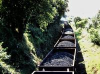 A loaded coal train snakes south through Pontyberem under the Heol Y Pentre road bridge in 1982.<br><br>[Andrew Saunders&nbsp;//1982]