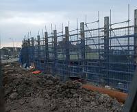 Dundee's new station progressing.<br><br> Beyond the mud and high fence is Dundee station in its cutting.<br><br>[John Yellowlees&nbsp;23/03/2016]