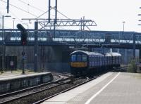 With pointwork and signalling for the closed Widnes line still intact 319377 leaves St Helens Central for Liverpool Lime Street on 11 March 2016. [See Image 41688] for a similar view without the recently erected catenary. <br><br>[Malcolm Chattwood&nbsp;11/03/2016]