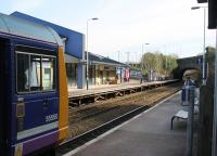 A Manchester Victoria to Blackburn service (via the reinstated Todmorden Curve), calls at Burnley Manchester Road on 14th March 2016. Closed originally in 1961, the station was reopened in 1986 but the new station building was only constructed in 2015. <br><br>[Mark Bartlett&nbsp;14/03/2016]