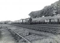 Fowler 2P 4-4-0 40689 approaching Kilwinning from the north on 4 July 1959 with a train from St Enoch destined for Ardrossan Town. [Ref query 4531]<br><br>[G H Robin collection by courtesy of the Mitchell Library, Glasgow&nbsp;04/07/1959]