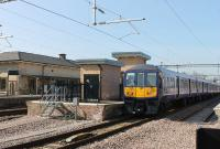 Northern Electric 319377 departs from the restored Platform 3 at Huyton on 14th March 2016 with a stopping service from Lime Street to Wigan.  In the foreground the line through Platform 4 comes to an abrupt halt but will eventually be connected. <br><br>[Mark Bartlett&nbsp;14/03/2016]