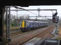 380 020 takes the bi-directional centre road through Cardonald with a fast Ayr - Glasgow service.<br><br>[Bill Roberton&nbsp;18/03/2016]