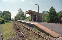 View west at Llanwrda Level Crossing. This station had staggered platforms and the disused former westbound platform is behind the camera.<br><br>[Ewan Crawford&nbsp;//2002]