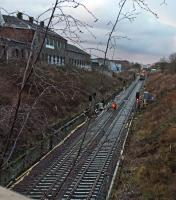 Evening shift clipping new rails onto sleepers set at new lower level to accommodate OHLE.<br><br>[Martin MacGuire&nbsp;30/03/2016]